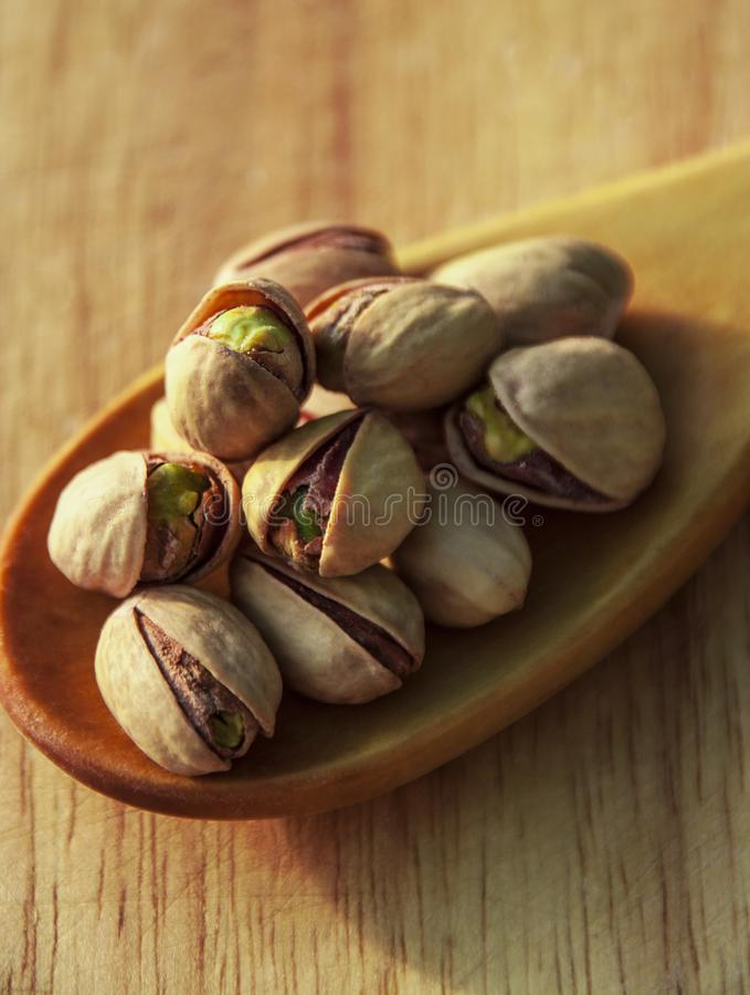 Pistachio nuts background. Pistachio nuts on wooden background stock photography