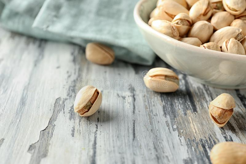 Pistachio nuts on wooden table, closeup stock image