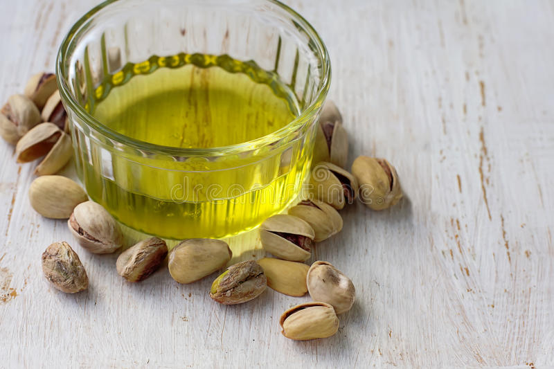 Pistachio oil with nuts. Selective focus royalty free stock photo