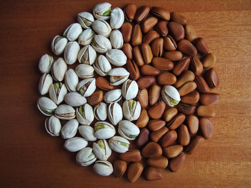 Pistachio and pine nuts stock photo