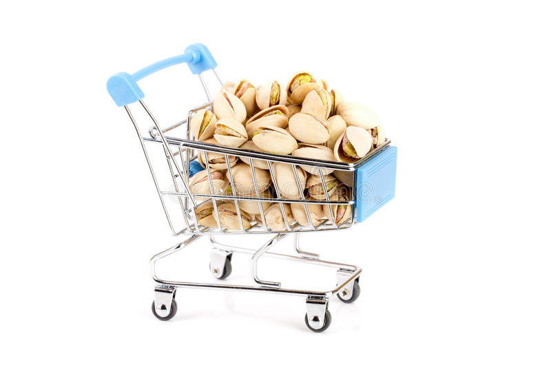 Pistachio in a shopping cart isolated on white background stock photo