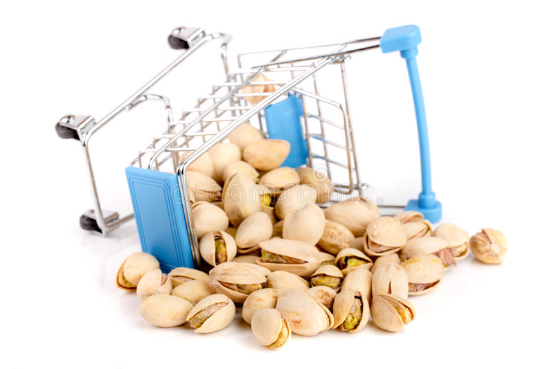 Pistachio in a shopping cart isolated on white background stock photos