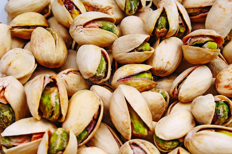Pistachio texture. Nuts. Green fresh pistachios as texture. Roasted salted pistachio nuts healthy delicious food studio stock image