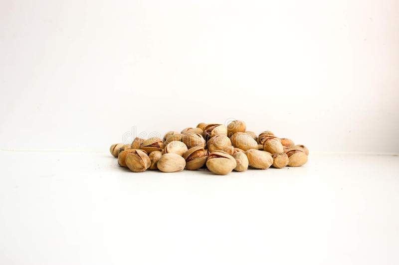 Pistachios the core a handful. Handful. On a white background. Photo for your design royalty free stock images