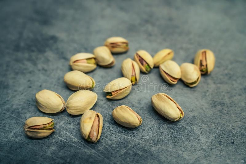 Pistachios on Counter. Modern, clean and stylish looking Pistachios on grey counter top. Great for food blogs and websites royalty free stock photo