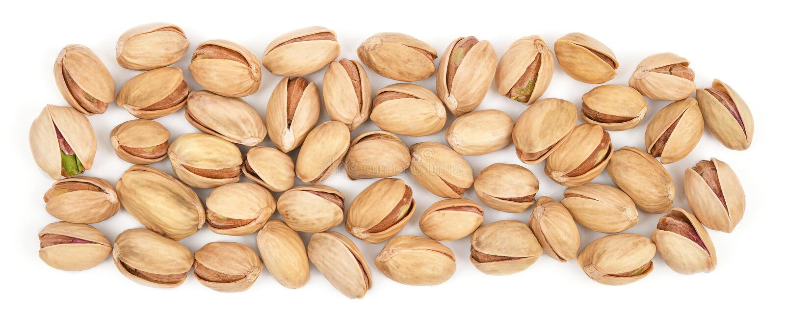 Pistachios isolated on white background. Panorama made of pistachio heap close-up. Nuts pile collection. Top view.  royalty free stock images