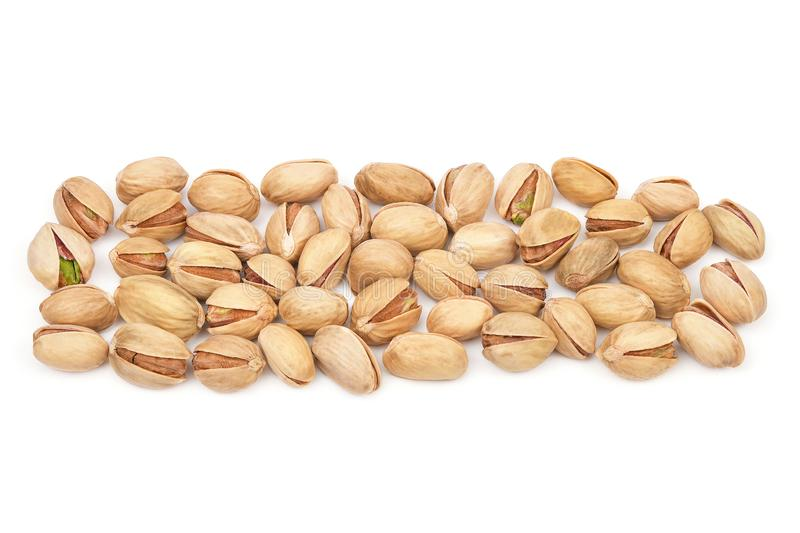 Pistachios isolated on white background. Panorama made of pistachio heap close-up. Nuts pile collection. Top view.  stock photography