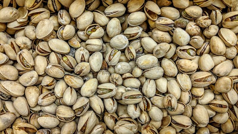 Pistachios in loose. Can be used as background or wallpaper and for other possibility or to modify to your taste royalty free illustration