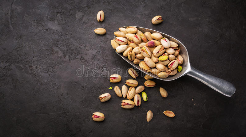 Pistachios in a scoop stock photo
