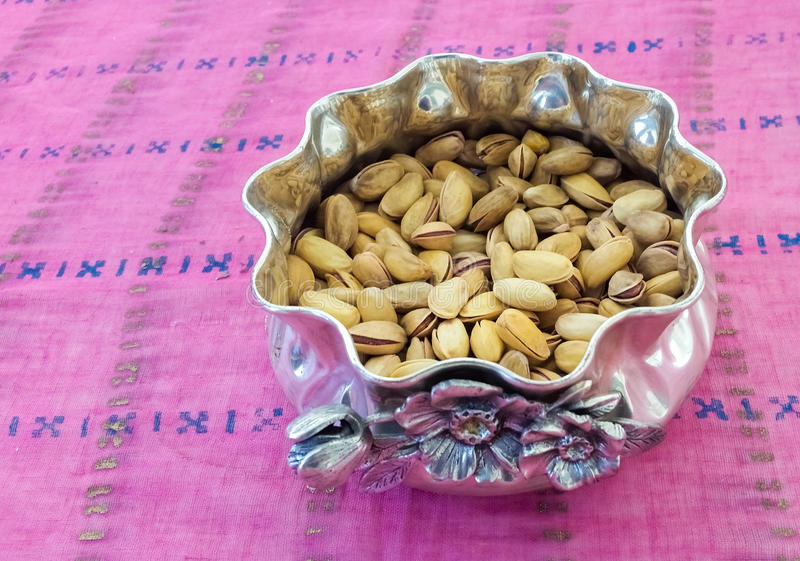 Pistachios in a Silver Bowl. Pistachios Served in a Silver Bowl stock photography