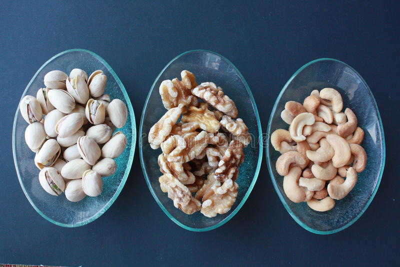 Pistaschvalnötter och kasjuer fotografering för bildbyråer