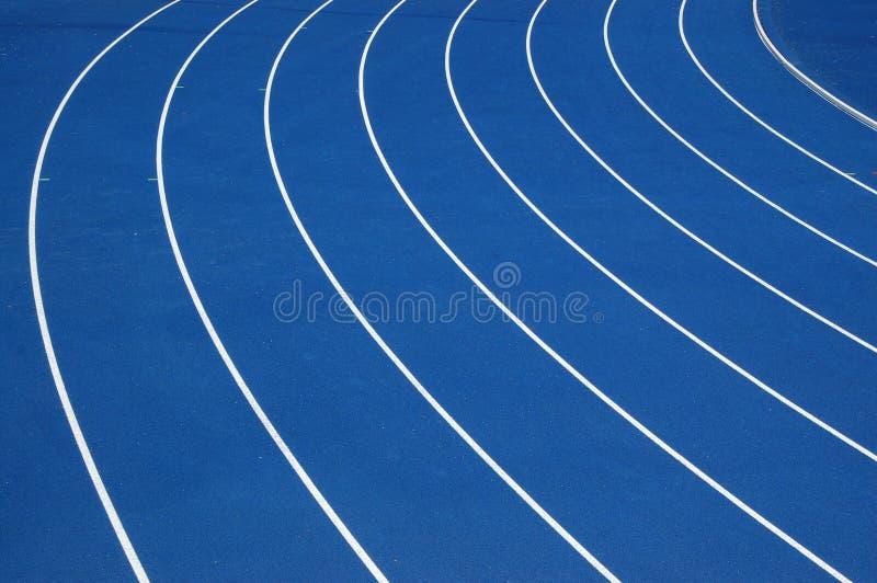 Piste courante bleue photographie stock libre de droits