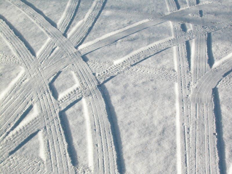pistes abstraites de neige de véhicule photo libre de droits