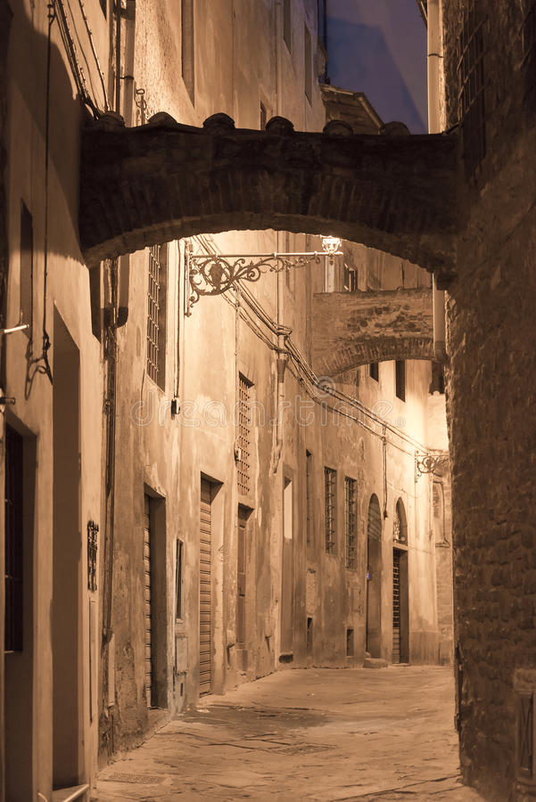 Pistoia (Tuscany, Italy). Typical street in the medieval town at evening royalty free stock image
