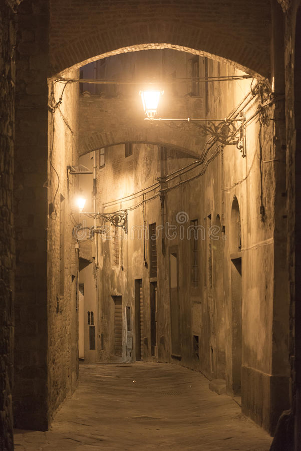 Pistoia (Tuscany, Italy). Typical street in the medieval town at evening stock photography