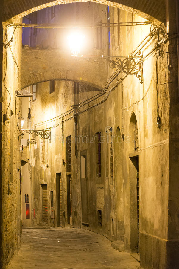 Pistoia (Tuscany, Italy). Typical street in the medieval town at evening royalty free stock photography
