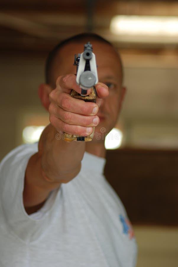 Pistol aiming to shoot royalty free stock photo