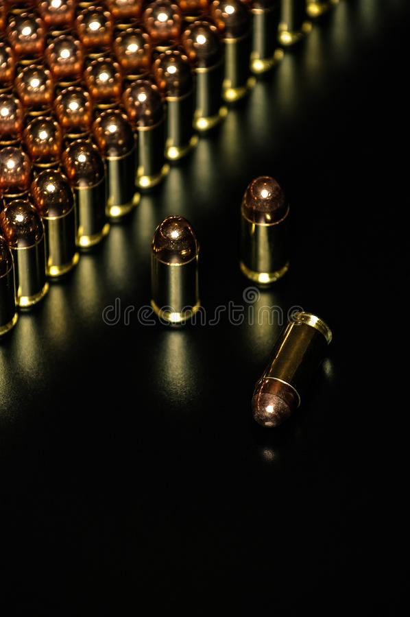 Pistol ammunition with the dark background stock images