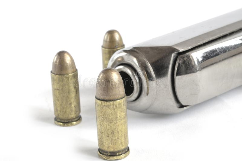 Pistol and ammunition. On the white background stock images