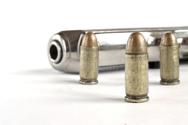 Pistol and ammunition. On the white background stock photos