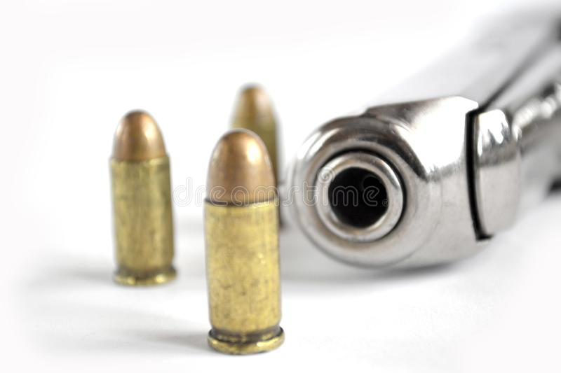 Pistol and ammunition. On the white background royalty free stock image