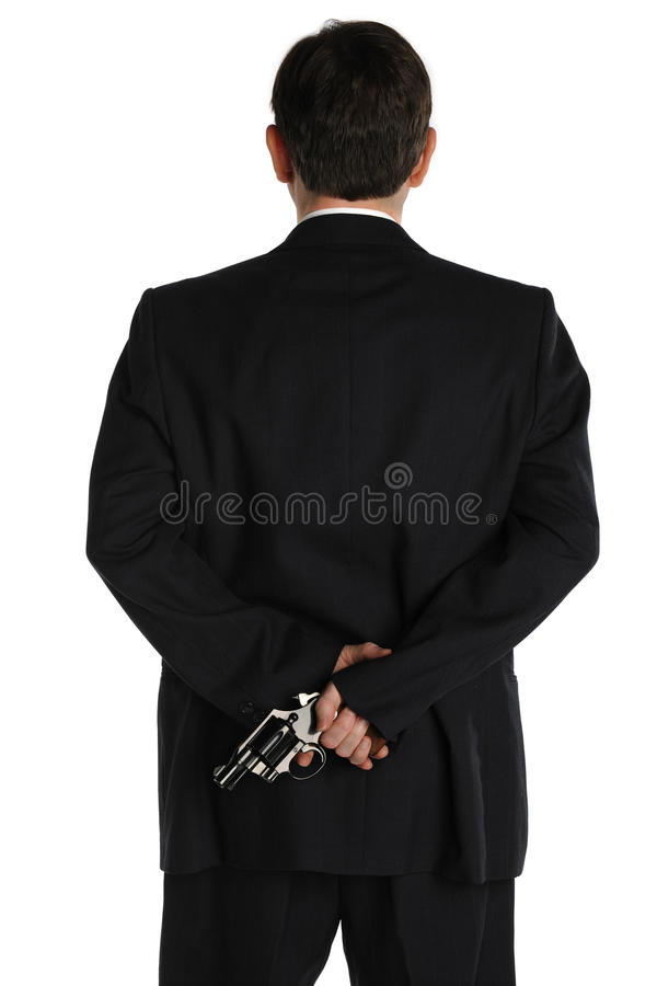 Pistol behind the suit royalty free stock image