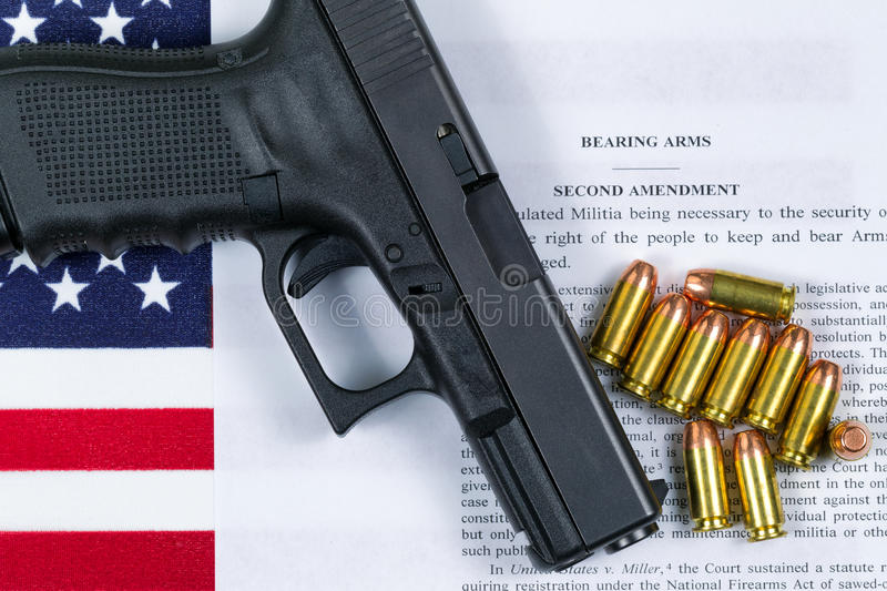 Pistol with flag and American paper for right to bear arms stock photos