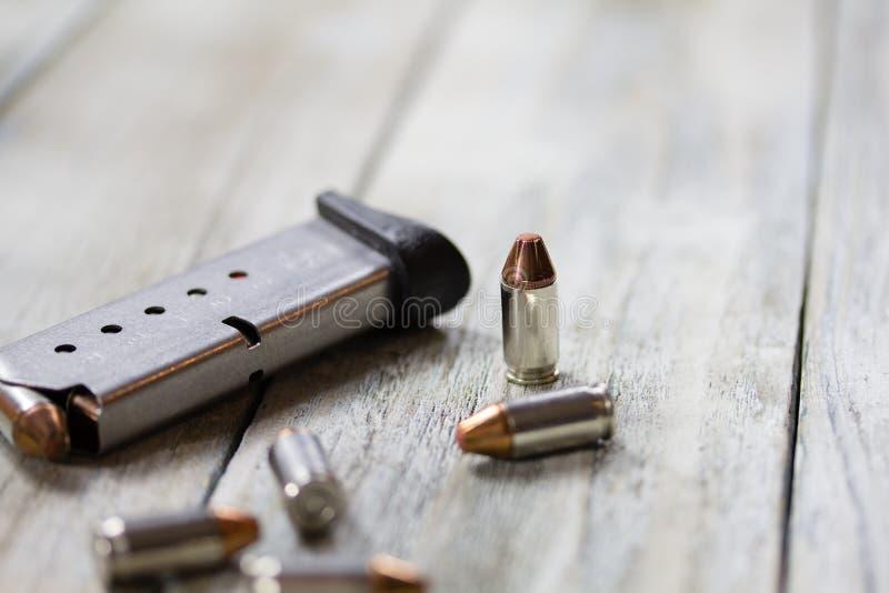 Pistol Handgun Magazine Clip and Bullets royalty free stock photo