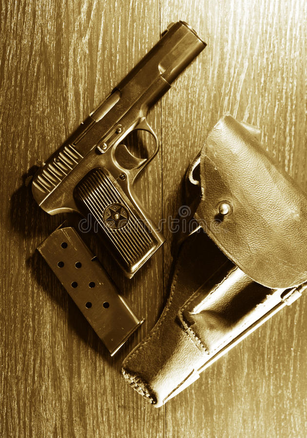 Pistol And Holster. World War II Soviet equipment. Leather handgun holster and pistol royalty free stock images