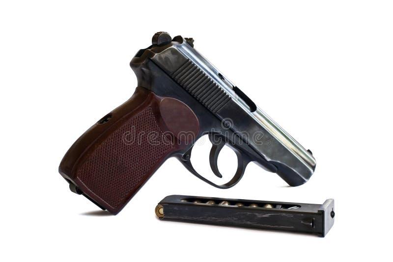 Pistol med ammunitionar som isoleras på vit bakgrund royaltyfri fotografi