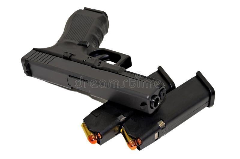 Pistol med kulor royaltyfri foto