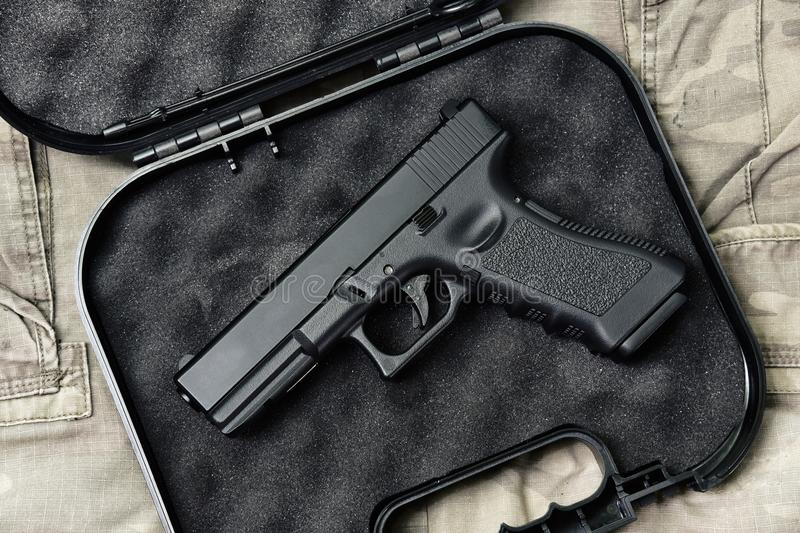 Pistol 9mm, Gun weapon series, Police handgun close-up. Pistol 9mm, Gun weapon series, Police handgun close-up on camouflage background royalty free stock images