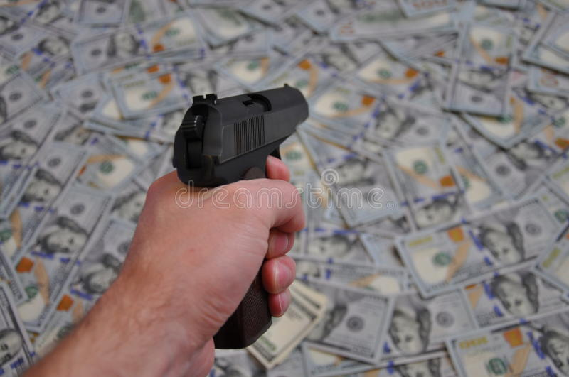 Pistol and money. The pistol directed on the money royalty free stock images
