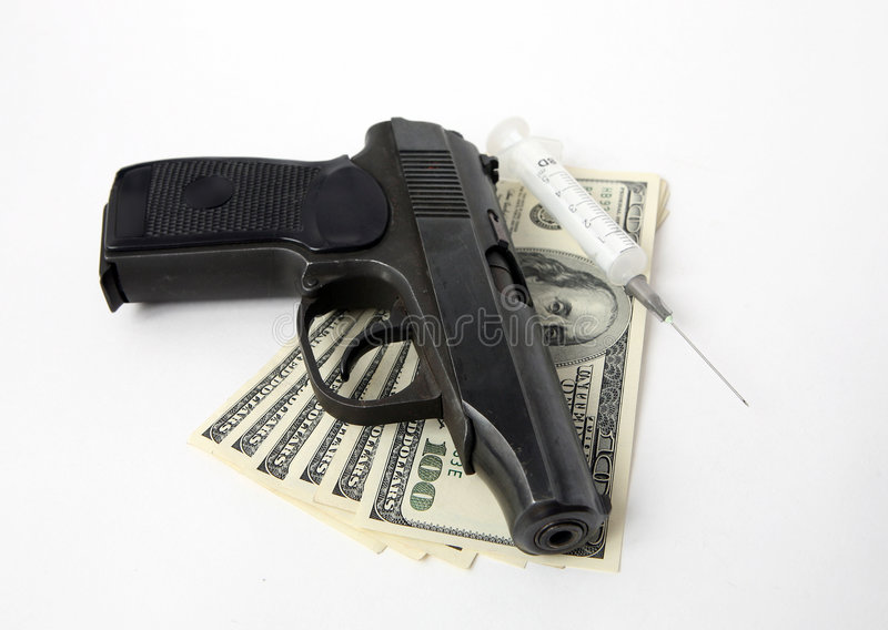 Pistol, money and syringe. On white background stock images