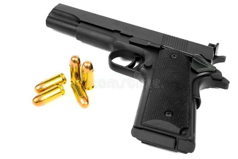 Pistol och kula royaltyfri bild