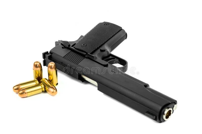 Pistol och kula royaltyfri foto