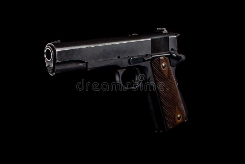 Pistol 1911 på svart arkivfoton