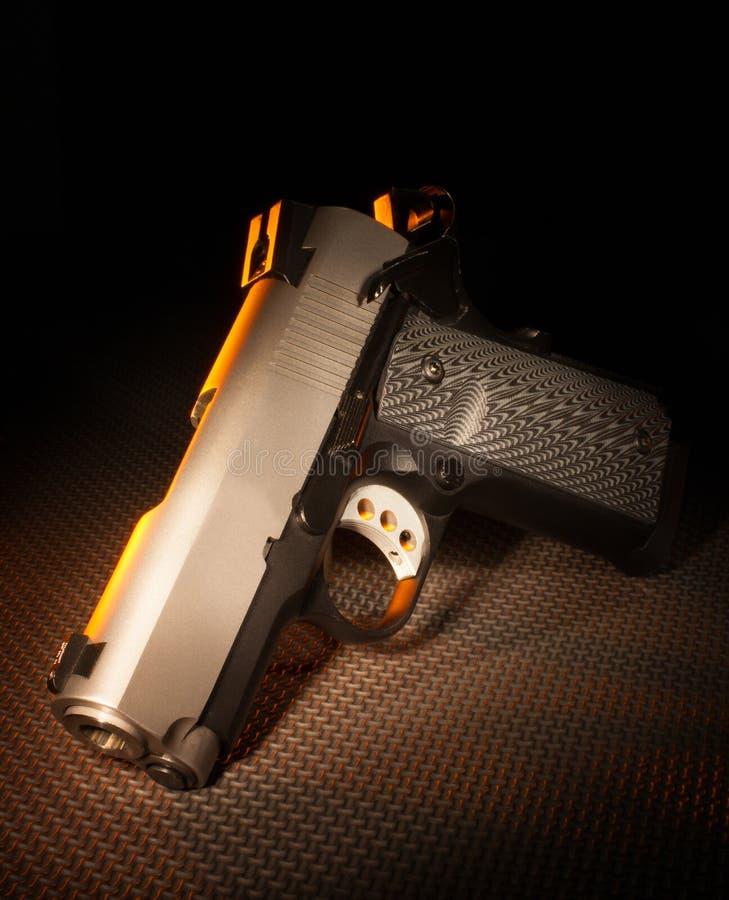 Download Pistol stock photo. Image of muzzle, silver, black, brass - 35516244
