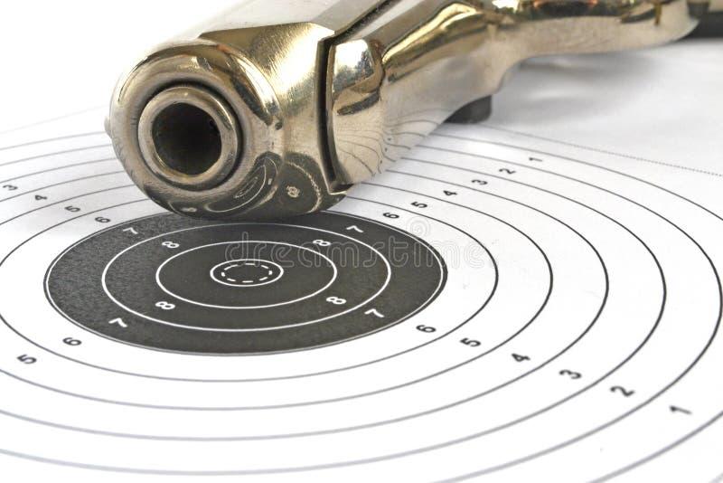 Pistol and target stock photos