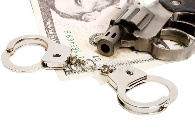A pistola algema o dinheiro imagem de stock