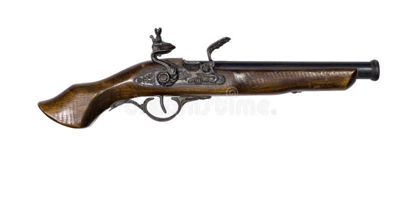 Pistola antigua con un fusil de chispa en un fondo blanco imagenes de archivo