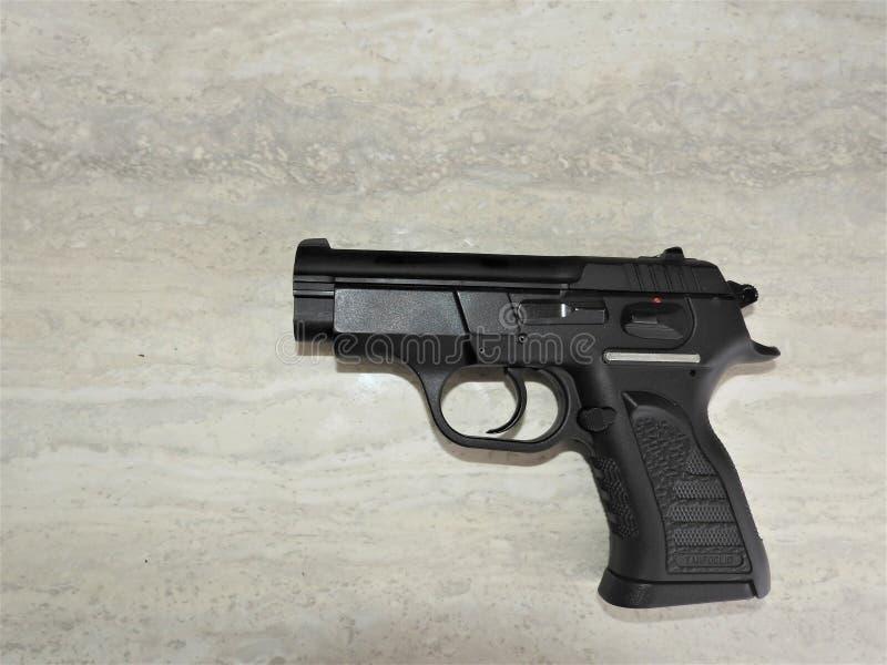 Pistola brutal negra del tanfoglio compartimentada en 9m m foto de archivo