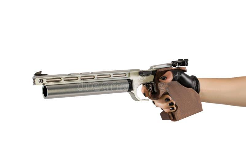 Pistola della mano della tenuta della donna sul fondo bianco del fondo che cliping fotografia stock