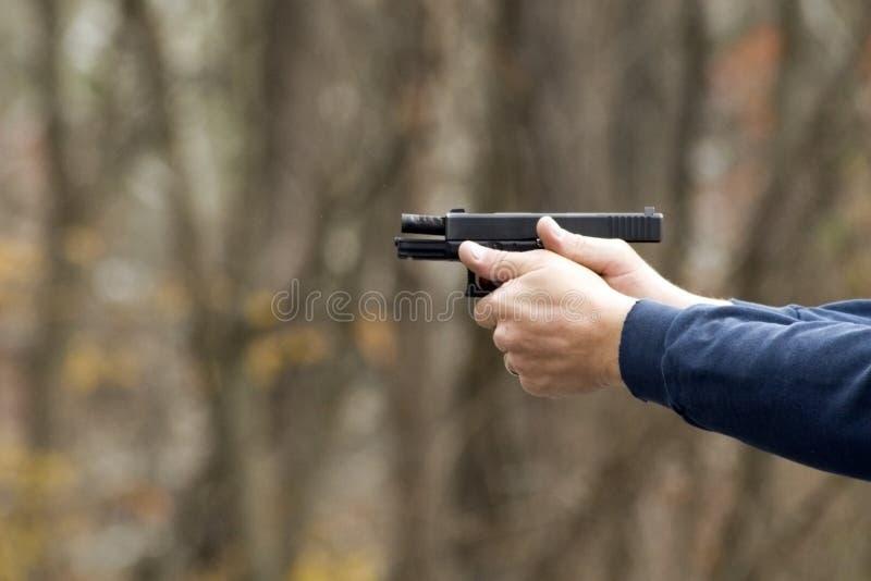 Pistola, diapositiva detrás fotografía de archivo libre de regalías