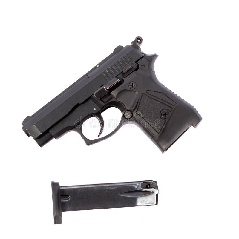 Pistola e la sua rivista fotografia stock libera da diritti