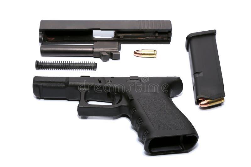Pistola e munizioni smontate fotografie stock libere da diritti