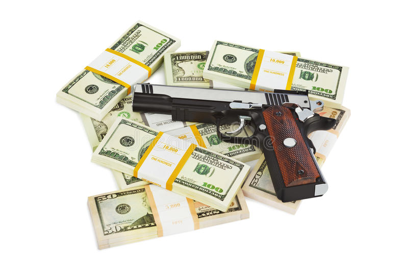 Pistola e soldi fotografie stock