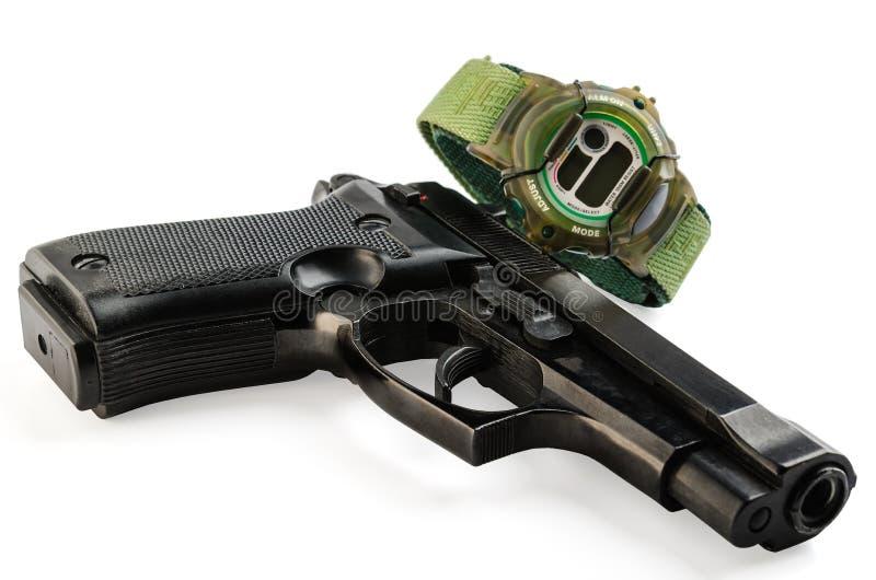 Pistola ed orologio elettronico immagini stock libere da diritti