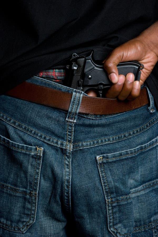 Pistola in pantaloni immagini stock libere da diritti