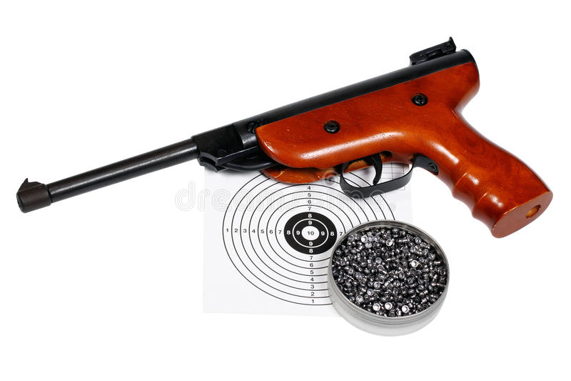 Pistola pneumática com arma-protetor e pelotas na caixa imagens de stock